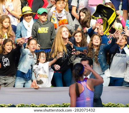 MADRID, SPAIN - MAY 5 :  Ana Ivanovic throws her towel to lucky fans at the 2015 Mutua Madrid Open WTA Premier Mandatory tennis tournament - stock photo