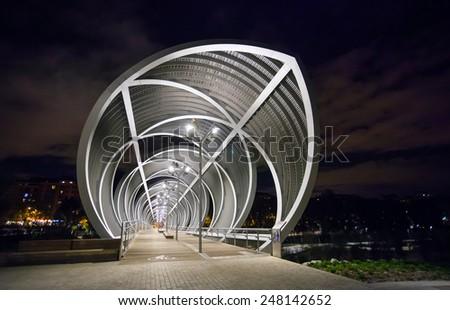 Madrid, Spain - May 5, 2012: Arganzuela Bridge illuminated on a spring night and Madrid Rio Park, Madrid, Spain - stock photo