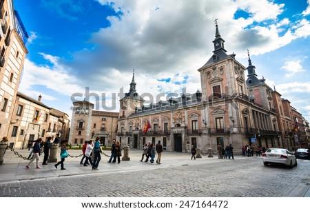 Madrid, Spain - May 6, 2012: Casa de la Villa in Villa Square (Plaza de la Villa) the City Hall of Madrid with tourist walking on a spring day, Spain - stock photo