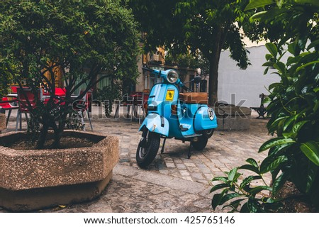 Madrid, Spain - May 10, 2016: Old Vespa parked on old street in Madrid, Spain - stock photo