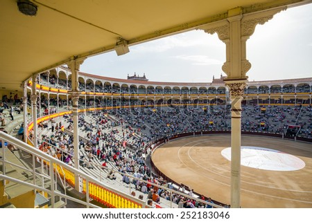 Madrid, Spain - May 11, 2012: Plaza de Toros de Las Ventas interior view with tourists gathering for the bull show in Madrid on a sunny day, Spain - stock photo