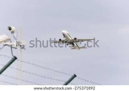 MADRID, SPAIN - MAY 3th 2015: Aircraft -Airbus A320-, of -Alitalia- airline, is taking off from Madrid-Barajas -Adolfo Suarez- airport, on May 3th 2015. - stock photo