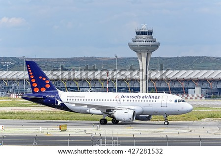 MADRID, SPAIN - MAY 15th 2016: Aircraft -Airbus A319- of -Brussels Airlines- airline, direction to airport terminal of Madrid-Barajas -Adolfo Suarez- airport, after it has landed, on May 15th 2016. - stock photo