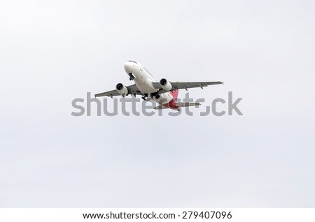 MADRID, SPAIN - MAY 3th 2015: Aircraft -Airbus A319-, of -Iberia- airline, is taking off from Madrid-Barajas -Adolfo Suarez- airport, on May 3th 2015. - stock photo