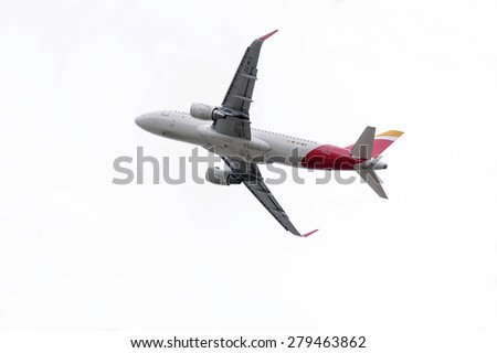 MADRID, SPAIN - MAY 3th 2015: Aircraft -Airbus A320-, of -Iberia- airline, is taking off from Madrid-Barajas -Adolfo Suarez- airport, on May 3th 2015. - stock photo