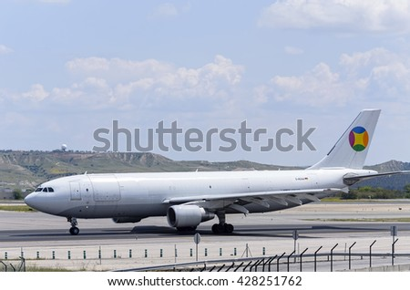 MADRID, SPAIN - MAY 15th 2016: Cargo -Airbus A300-, of -DHL European Air Transport- airline, is going direction to runway,ready to take off from Madrid-Barajas -Adolfo Suarez- airport,on May 15th 2016 - stock photo