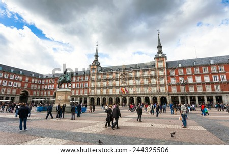 Madrid, Spain - May 5, 2012: Tourists visiting Plaza Mayor in Madrid, Spain - stock photo