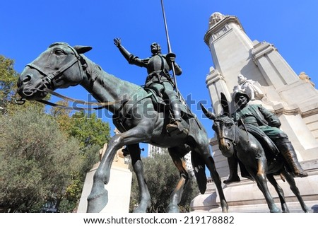 Madrid, Spain - monuments at Plaza de Espana. Famous fictional knight, Don Quixote and Sancho Pansa from Cervantes' story. - stock photo