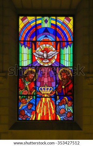 MADRID, SPAIN - NOVEMBER 13, 2015: Stained Glass window depicting the Holy Trinity in the Cathedral of Madrid, Spain.