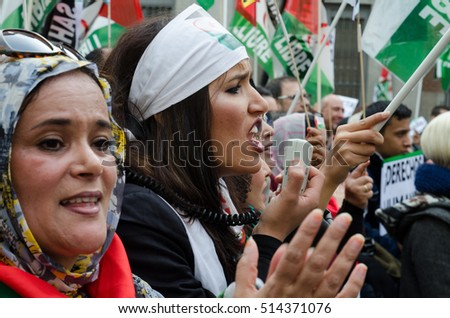 MADRID, SPAIN - 12 November, 2016: Women shouting using a megaphone during the demonstration for a free Sahara held in Madrid.