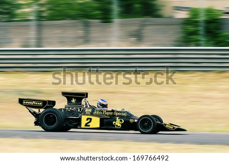 MADRID, SPAIN - OCT 30 : A driver races in a classic Jacky Ickx Lotus 76 during the Jarama Vintage Festival, on Oct 30, 2011 in Madrid, Spain. - stock photo