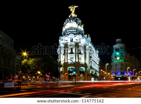 MADRID, SPAIN - OCTOBER 4: Night view of Madrid with Metropolis Building and Gran Via Street inaugurated on January 21, 1911, on October 4, 2012 in Madrid