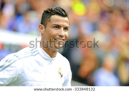 MADRID, SPAIN - October 31st, 2015 :  portrait of Portuguese CRISTIANO RONALDO of REAL MADRID smiling when entering the pitch during Spain La Liga match vs Las Palmas at Santiago Bernabeu Stadium  - stock photo