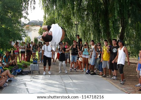 MADRID, SPAIN-SEPT. 18: A group of unidentified young men dance breakdance at 1st internaitonal Graffiti and Dance festival international in Madrid, Spain on September 2012.