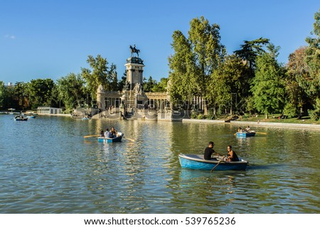 MADRID, SPAIN - SEPTEMBER 17, 2016: 130 hectare Parque del Buen Retiro is the most popular park in Madrid. Retiro Park was created as a royal park and opened to the public in 1868.