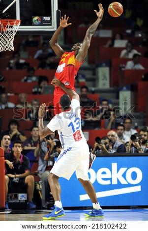 MADRID, SPAIN - September 10th 2014 : SERGE IBAKA of Spain and BORIS DIAW of France during the 1/4 final game of the FIBA BASKETBALL WORLD CUP 2014 at Palacio de los Deportes Arena - stock photo
