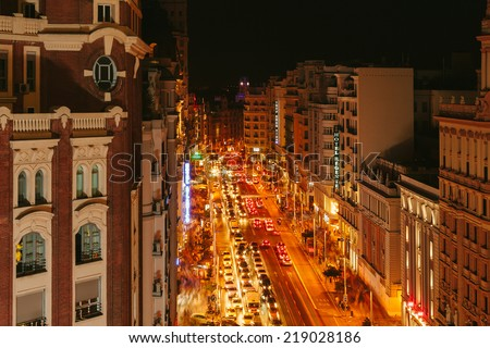 MADRID, SPAIN - SEPTEMBER 20: View Gran Via at night, one of the main streets and most famous landmarks of the city, on September 20, 2014 in Madrid, Spain - stock photo