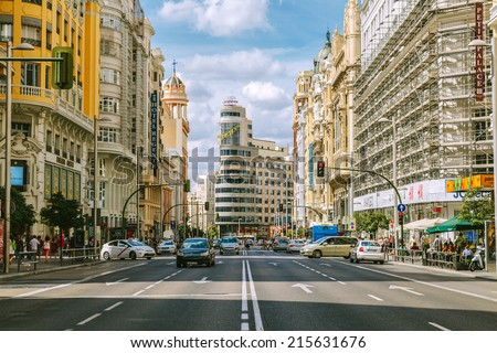 MADRID, SPAIN - SEPTEMBER 7: View Gran Via with the Capitol Building, one of the main streets and most famous landmarks of the city, on September 7, 2014 in Madrid, Spain