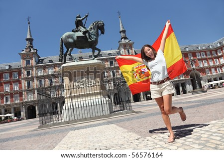 Madrid woman tourist on Plaza Mayor screaming with Spain flag. - stock photo