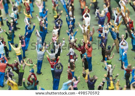 MADURODAM, NETHERLANDS - JULY 7, 2015: A crowd of people in miniature in Madurodam, where can appreciate the architecture of Holland in miniature.