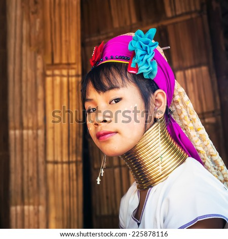 MAE HONG SON, THAILAND - DEC 4, 2013: Unidentified Karen (Kayan Lahwi Padaung) Long Neck woman with traditional brass coils and clothes in tribe village. Chang Mai province, Thailand - stock photo