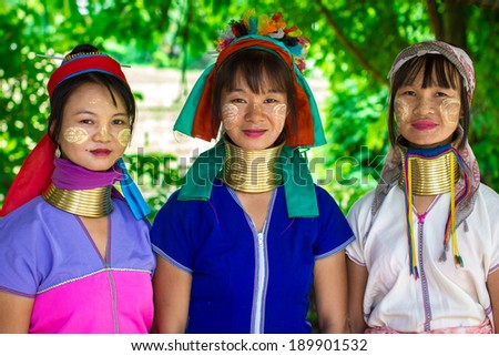 Mae Hong Son, Thailand - July 22, 2013: Karen tribe women from the Padaung tribe poses for the camera in Mae Hong Son on July 22, 2013. Karen people wear rings on their neck from as young as five.