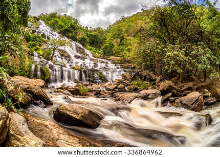 Mae Ya waterfall in Doi Inthanon National Park,Thailand,Most Famous in Thailand, Beautiful silky waterfall flow through stones. - stock photo