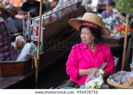 MAEKLONG, OCT 1: Train passing through the famous open air railway markets at Maeklong market in Samut Songkhram Province close to Bangkok, on Oct 1, 2016.