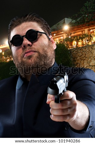 Mafia gangster pointing a gun to you - stock photo