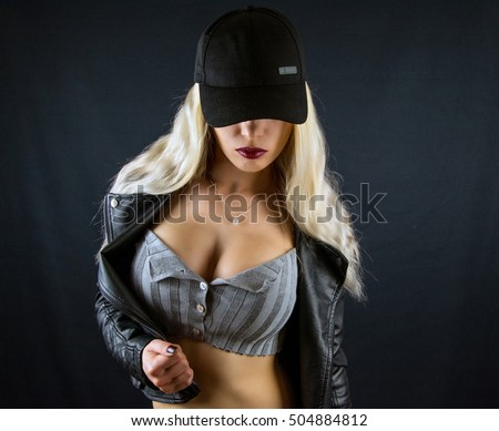 mafia girl limited black style edition / Big breasts in black bra from above / Woman with big breasts /  Beautiful slim body of woman in studio in black skin jacket / hot sexy blonde girl / new photo