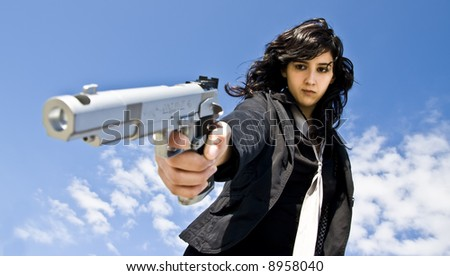 Mafia girl shooting at cold blood - stock photo
