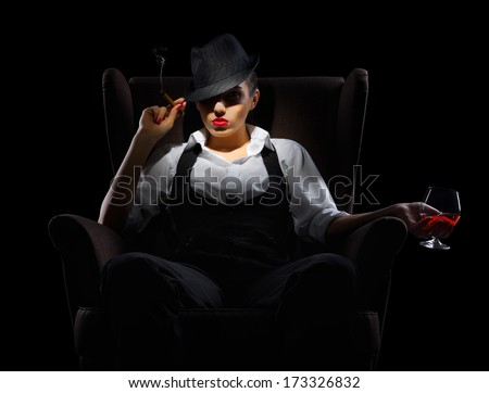 Mafiosi woman with cigar and cognac glass isolated - stock photo