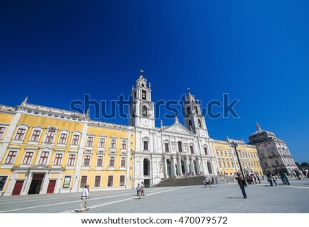 MAFRA, PORTUGAL - JULY 17, 2016: Facade of the Basilica at the Palace of Mafra, Portugal, a famous royal palace built in the 18th Century.