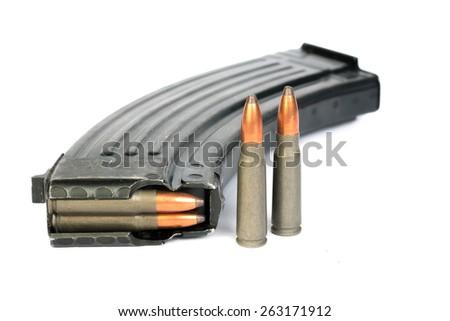 Magazine and bullet shells   - stock photo