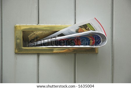 Magazine delivered into letterbox. - stock photo