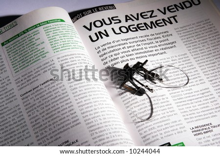 magazine in black and green color text with oldest small glasses - stock photo