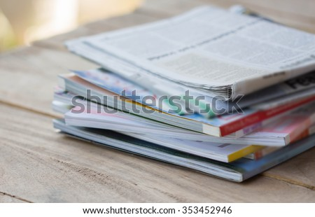 Magazine on a wooden table. - stock photo