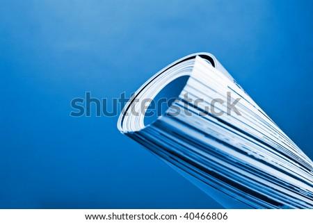 Magazine roll blue toned - stock photo