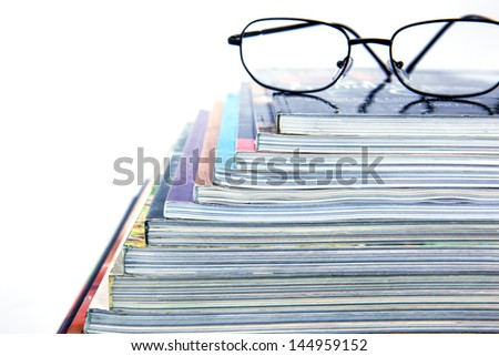 magazine stack on white background - stock photo