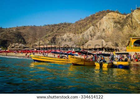 MAGDALENA, COLOMBIA - FEBRUARY 20, 2015: Touristic boats in the caribbean beach of Playa Blanca, Santa Marta - stock photo