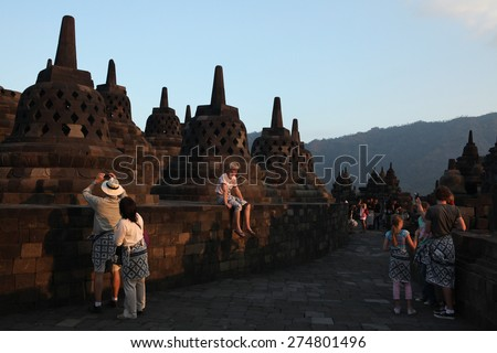 MAGELANG, INDONESIA - AUGUST 1, 2011: Tourists visit the Borobudur Temple in Magelang, Central Java, Indonesia. - stock photo