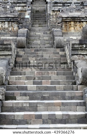 MAGELANG, INDONESIA - FEBRUARY 2, 2011: Ancient stone staircase in Borobudur Temple. Borobudur buddhist temple is a UNESCO world heritage site. - stock photo