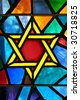 Magen David star glass painting at synagogue - stock photo