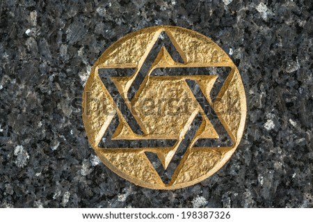 Magen David (star of David) on a grave in the Montparnasse cemetery, Paris, France - stock photo