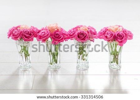 magenta roses with one coral rose on white background