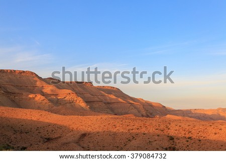 Magestic mountains landscape at the bottom of the Big Crater (HaMakhtesh HaGadol) in Israel - stock photo