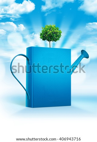 Magic book of knowledge against the sky in the form of a watering can with a growing tree. Magic book - stock photo