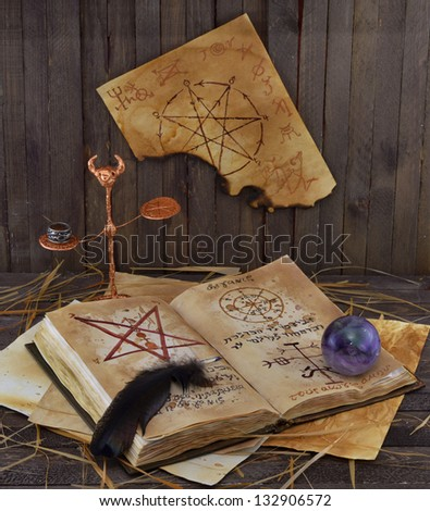 Magic book with scales and ball - stock photo