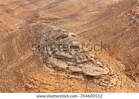 Magic desert landscape in the National geological park Yeruham Park in the Negev desert. Geological erosion land form in stone desert. Israel - stock photo