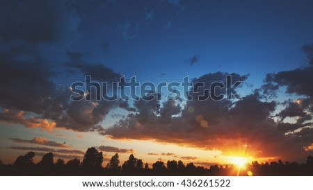 Magic eve. Sunset over the tree silhouette, beauty skies - stock photo